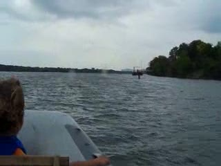 Zooming along on the Illinois River in our Dinghy from:DotComd