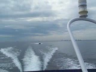 A Baja go fast boat passing me and jumping my wake from:DotComd